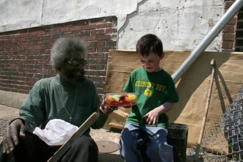 Eli giving Herman fruit